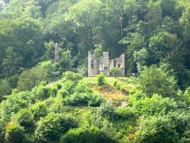 Castle ruins on the shores of Lake Windermere, Lake District, United Kingdom.