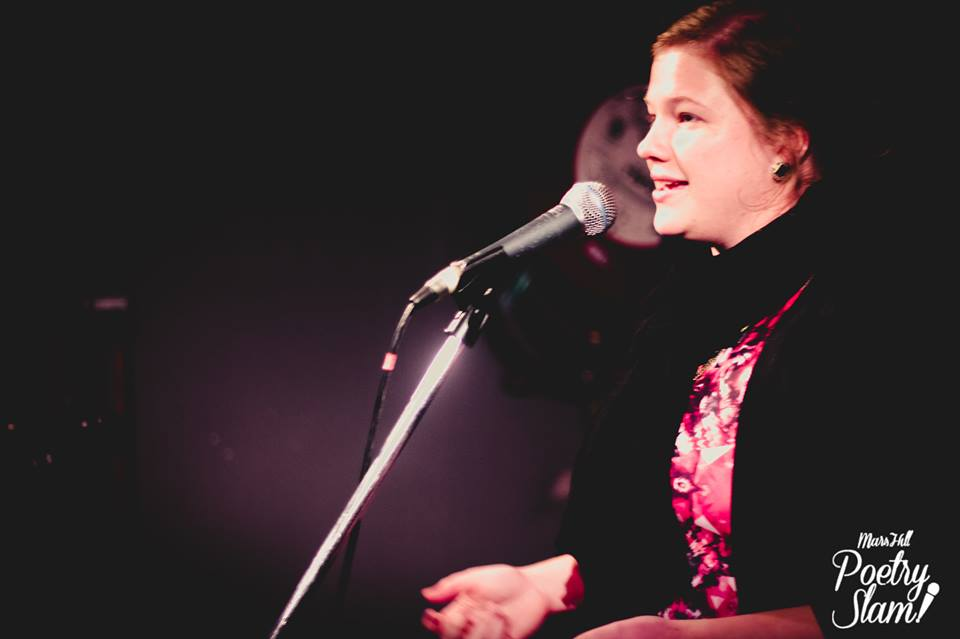 Spoken word poet, Lorin Reid performs at a Poetry Slam.