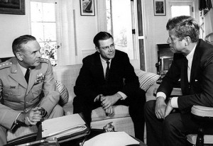 Nearly a year on from the Cuban Missile Crisis, JFK meets with General Maxwell D. Taylor and Secretary Robert S. McNamara, at the Oval Office, White House. Photography: Abbie Rowe, National Park Service, in the John F. Kennedy Presidential Library and Museum. Image Source: Manhhai, Flickr. Click through link.